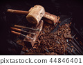 wooden hammer and chisels on sawdust 44846401
