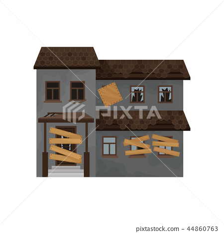 Big house with destroyed roof, boarded-up windows and door. Abandoned building. Facade of old 44860763