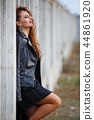 Glam rock style girl in leather jacket 44861920