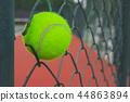 tennis ball on grating 44863894