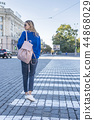 woman walking on a pedestrian crossing 44868029