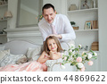 Happy family. Dad and daughter together at home 44869622