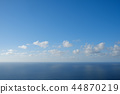 blue sky  above ocean horizon with clouds 44870219