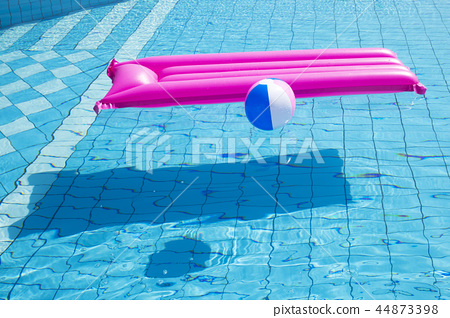 Summer holiday concept photo. vacation items and beach accessories in swimming pool or yellow background. 152 44873398