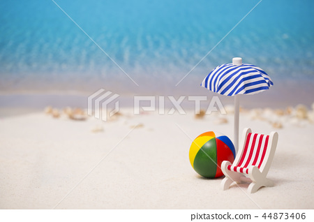 Summer holiday concept photo. vacation items and beach accessories in swimming pool or yellow background. 090 44873406