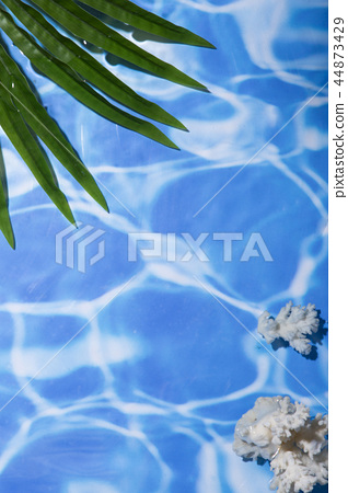 Summer holiday concept photo. vacation items and beach accessories in swimming pool or yellow background. 031 44873429