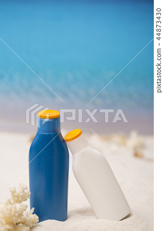 Summer holiday concept photo. vacation items and beach accessories in swimming pool or yellow background. 093 44873430