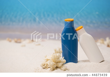 Summer holiday concept photo. vacation items and beach accessories in swimming pool or yellow background. 095 44873439