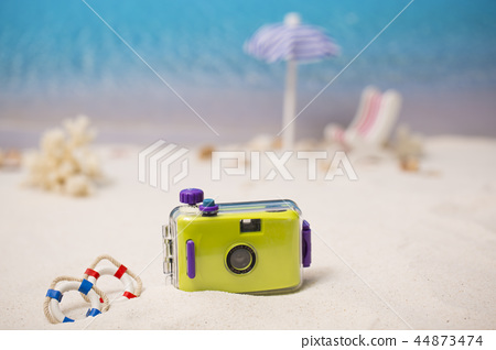 Summer holiday concept photo. vacation items and beach accessories in swimming pool or yellow background. 097 44873474