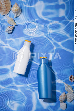 Summer holiday concept photo. vacation items and beach accessories in swimming pool or yellow background. 009 44873502