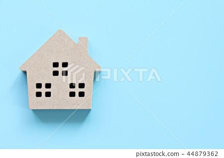 Wood house model on blue background 44879362