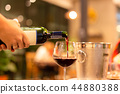 Red wine from bottle into wine glass 44880388