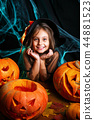 Happy halloween. Pretty little child girl in witch costume with carving pumpkin . Happy family 44881523