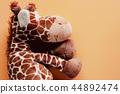 Giraffe soft toy and plush animal doll 44892474