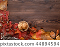 autumn leaves, cookies and cinnamon on wooden background 44894594