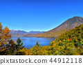 Man's body and Chuzenji lake dyed in autumn leaves 44912118