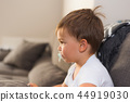 Portrait of a small cute kid with pacifier 44919030