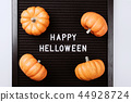 Happy Halloween words on black letter board in frame with pumpkins. 44928724