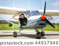 young man in small plane cockpit outdoors 44937949