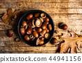 Acorns on a rustic wooden table 44941156