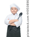 Portrait of cute boy chef hold spoon with cook hat 44950896