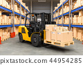 Forklift truck with cardboard boxes in warehouse 44954285