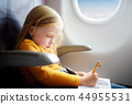 Adorable little girl traveling by an airplane 44955531