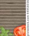 Basil leaves on wooden background with tomatoes.  44956036