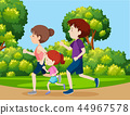 A family jogging in the park 44967578
