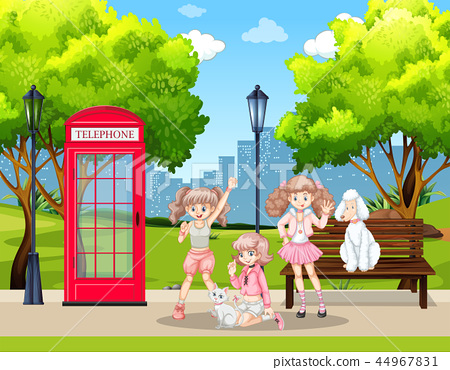 Girls and pet dogs in park 44967831
