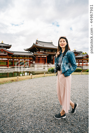 tourist relaxing standing in front of the temple 44967981