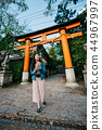 asian traveler walking pass the Torii 44967997