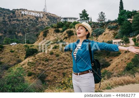 female traveler relaxing feeling the nature 44968277