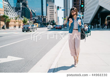 office lady waiting beside the road after work 44968330