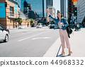 beautiful woman beckoning the taxi 44968332