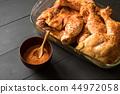 tasty chicken legs before roast 44972058