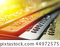 Gold and platinum credit cards close up 44972575