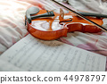Violin and the sheet of music note on the bed 44978797