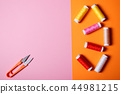 Sewing threads and scissors on bright background. 44981215