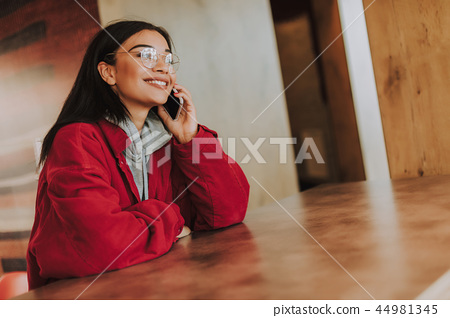 Delighted young woman sitting in the cafe 44981345
