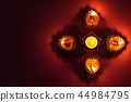 Happy Diwali - Clay Diya lamps lit during Dipavali 44984795