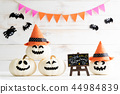 White and yellow ghost pumpkins with witch hat  44984839