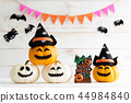 White and yellow ghost pumpkins with witch hat 44984840