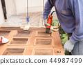 Carpenter at work with angular Sander. 44987499