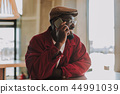 Cheerful man talking on the phone and smiling happily 44991039