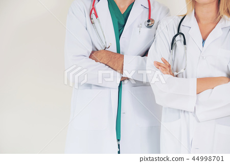Portrait of confident doctors with arms crossed. 44998701
