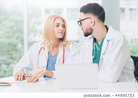 Two doctors partner works at office in hospital. 44998783