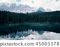 The Karersee lake with reflection of mountains in the Dolomites. 45003378