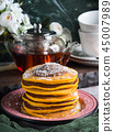 Pumpkin pancakes stack served with chocolate 45007989