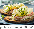 Rye bread toasts with cheese, ham, cucumber 45008045
